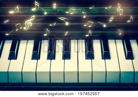 Closeup keyboard of piano with music notes musical instrument