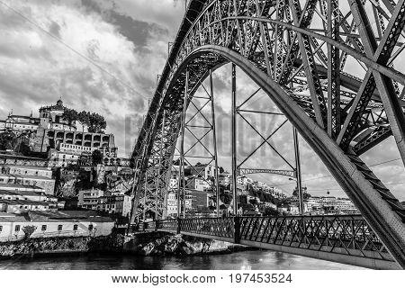 Dom Luís I Bridge in Porto (Portugal) in black and white.