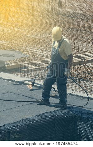Insulation Worker With Blowtorch