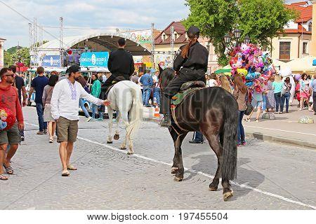KAMIANETS-PODILSKYI, UKRAINE - MAY 20, 2017: Horse police in the historic city of Kamianets-Podilskyi, Ukraine