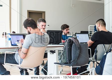 Istanbul Turkey - July 21 2017: Young college students studying with laptops in the university library/study room