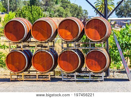 Eight Wine Barrels Stacked Outside A Winery