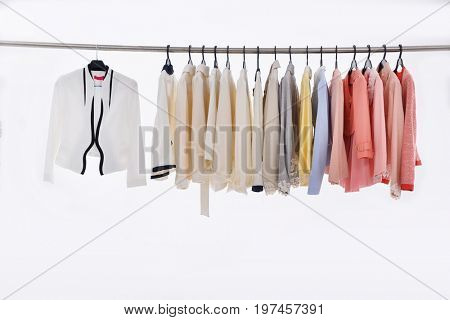 female clothes of different coat on hanger