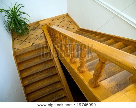 Wooden staircase leading down to the first floor