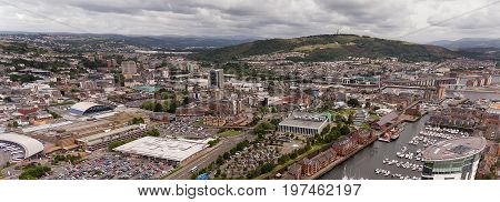 Editorial Swansea, UK - July 29, 2017: The commercial heart of Swansea City, showing the Marina, the bus station, the market and main shopping complex, superstores and the LC2 Leisure centre,