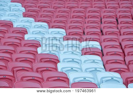 Rows of red football stadium seats with numbers.