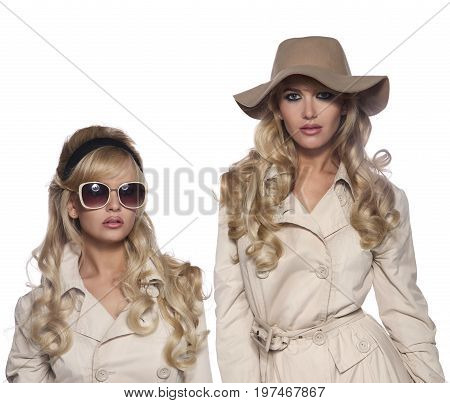 portrait of a beautiful blonde in retro style isolated on white background. in trench coat.