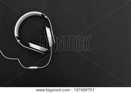 Headphone . headphone on wood table. Fashionable headphone on black background. selective focus of headphone.