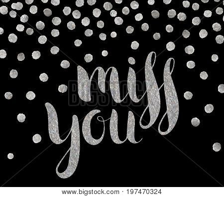 Handwritten calligraphic silver textured inscription Miss you on black background with silver dots. Lettering for postcard, Valentine day card, greeting, save the date card. Vector illustration.