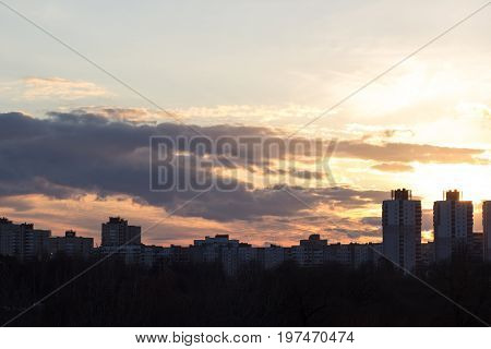 houses at sunset with backlighting in the city