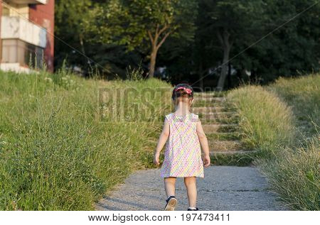 Small angel beauty in the sparkling sunset footpath
