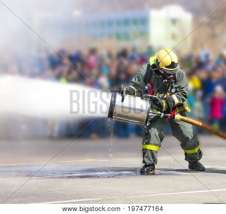 Firefighters while extinguishing the fire with a special fire extinguishing equipment