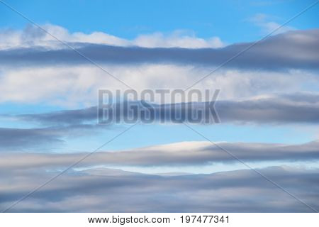 pattern formed by stratocumulus clouds adorn an early evening blue sky