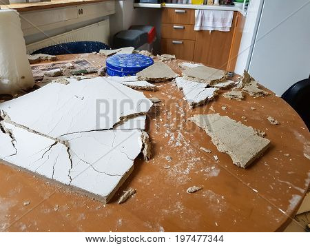 Ruined kitchen by collapsed ceiling. Severe water damage.