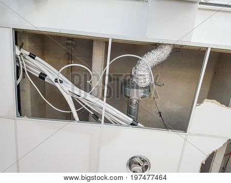 Ceiling panels damaged and collapsed by water. Rainwater leakage damage.