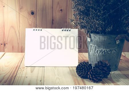 Vintage background decorate dry flower set on wooden table with blank note vintage filter and low key.