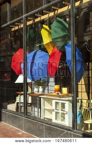 Providence Rhode Island USA - April 8 2007: Colorful umbrellas in store window display