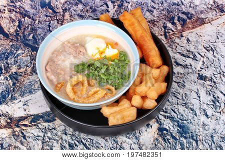 Pork's Rice Porridge Served With Deep-fried Dough Stick.