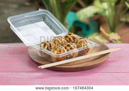 Japanese food Tako Yaki on Box / Takoyaki (octopus balls dumpling) / Fried battered squid balls traditional japanese food