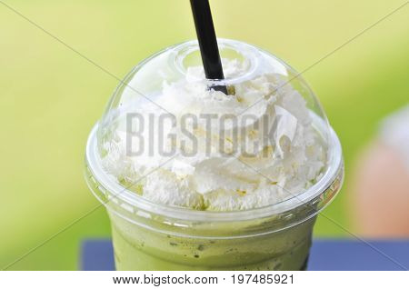 green tea frappe with whipped cream topping or green tea