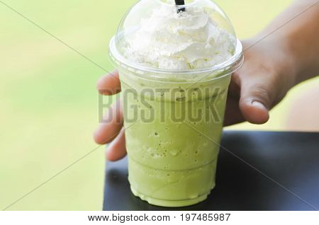 pick up a glass of green tea frappe or green tea frappuccino