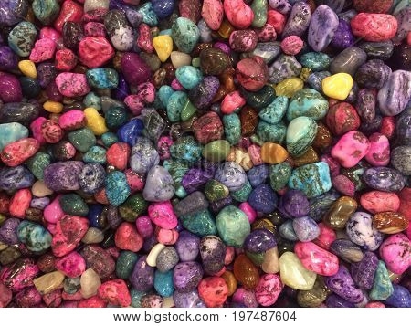 colorful stones. Background of colored semiprecious stones. Flat lay