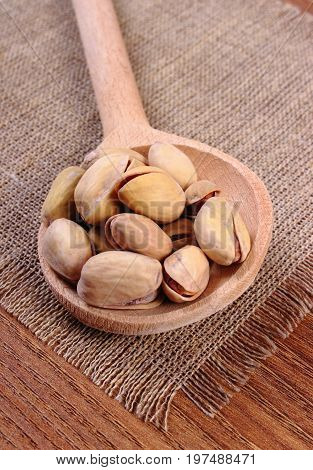 Pistachio Nuts With Spoon On Jute Canvas, Healthy Eating
