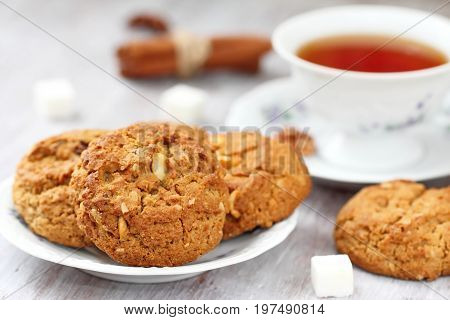 Cup Of Tea And Oatmeal Cookies With Nuts, Raisins  Cinnamon