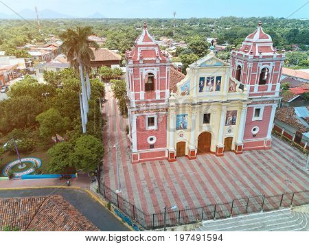 Old church in  Leon city in Nicaragua aerial view. Street in Leon