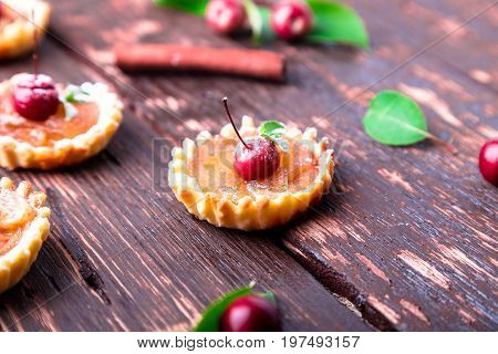 Apple Caramel Little Tarts On Brown Rustic Background. French Tatin With Paradise Apple.