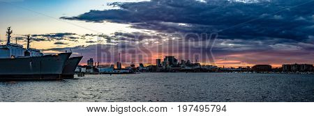 Baltimore Maryland USA - July 8 2017: Panoramic view of the Inner Harbor at sunset as viewed from the water.