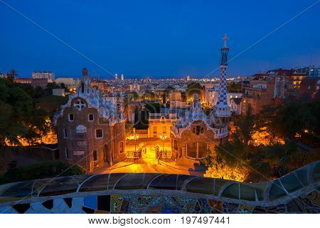 Gaudi bench and cityscape of Barcelona from park Guell at night, Spain