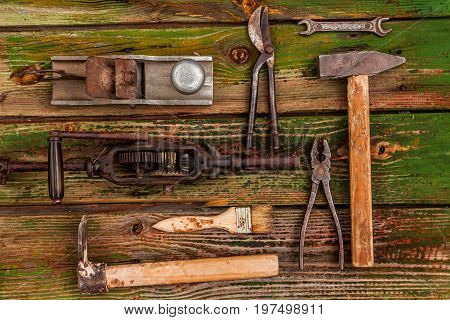 Old vintage hand tools on wooden background.