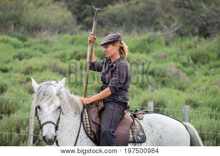 Cowgirl Portrait At Camargue Park On Delta Rhone River, France