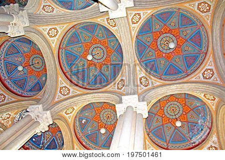 CHERNIVTSI, UKRAINE - APRIL 22, 2017: Beautiful patterns on the ceiling and colonnade in Chernivtsi University, Western Ukraine, Europe