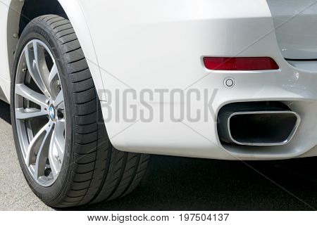 Sankt-Petersburg Russia July 21 2017 BMW F15 X5 M Perfomance. Tire and alloy wheel. Side view of a white modern luxury car. Car exterior details
