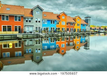 Beautiful colorful buildings on water at haven Groningen Netherlands Europe