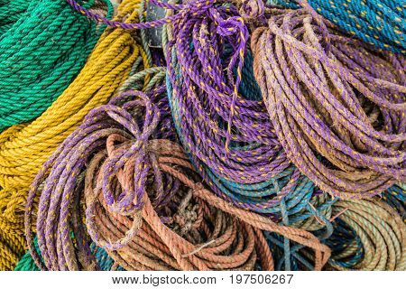 Colorful sink, hydropro and float ropes used for lobster traps piled up