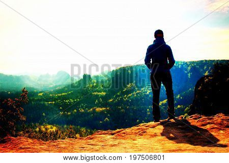 Film Grain. Alone Young Girl Tourist Feast Daybreak On The Sharp Corner Of Sandstone Rock And Watch