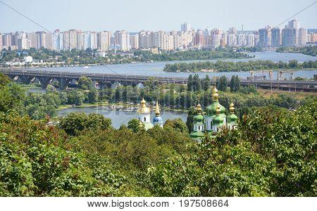 Left and right riversides of Dnipro. Bridges in Kyiv. Landscape scene on Dniper river through buildings of Kyiv. Kiev city Eurovision 2017 Ukraine.