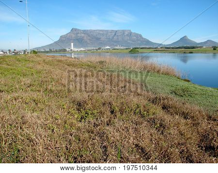 FROM CAPE TOWN. SOUTH AFRICA, MILNERTON LAGOON, WITH TABLE MOUNTAIN IN THE BACK GROUND