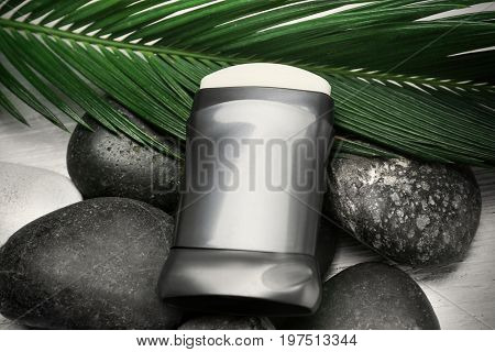 Deodorant on stones and palm leaf