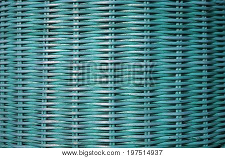 Front view of turquoise blue colored rattan furniture surface, for background and pattern