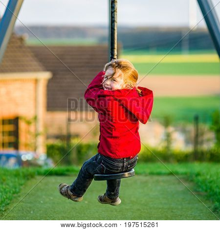 Cute Little Girl Playing On Children Playground