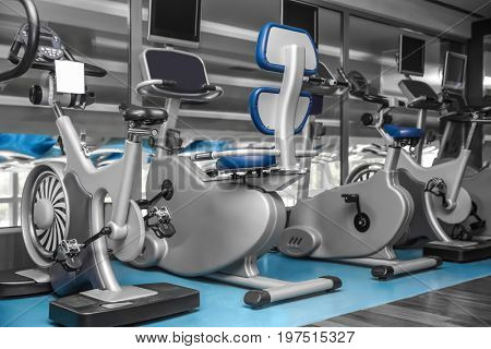 Interior of modern gym with machines