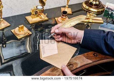 Fountain pen with ink and blank sheets of paper on wood background gold , writes a letter