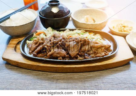 Japanese food set of sliced beef steak with fried vegetable a bowl of steamed rice and miso soup