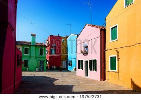 Colorful houses on the street of Burano in Italy