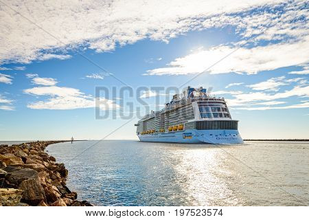 Port Adelaide South Australia February 14 2017: MS Ovation of the Seas cruise ship leaving Outer Harbour. It is third ship in the Quantum Class of passenger ships