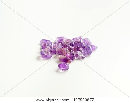 Tumbled Amethyst Stones Close Up On Table For Crystal Therapy Treatments And Reiki